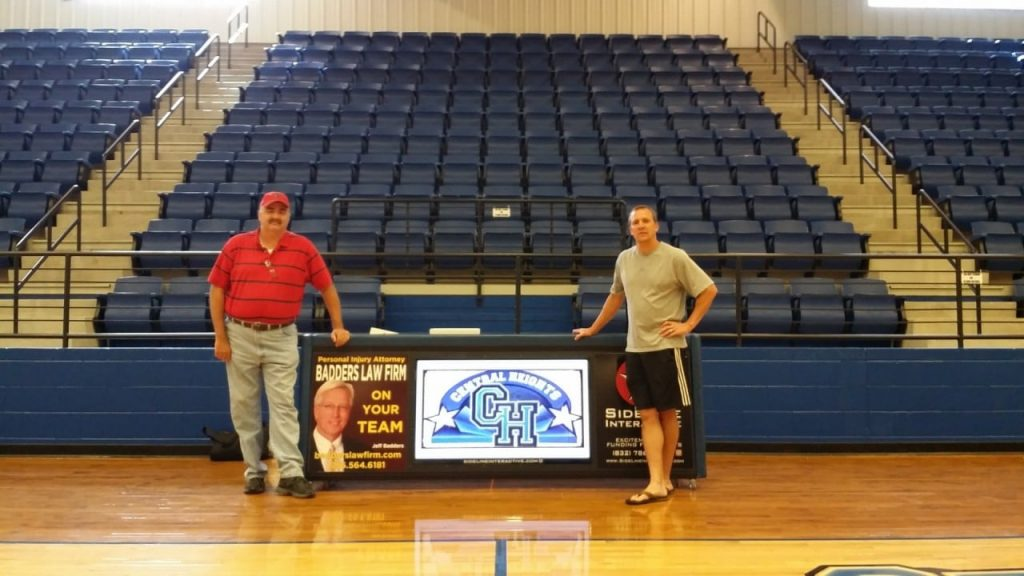 Coach Herron with his 8ft digital scoring table at Central Heights High.